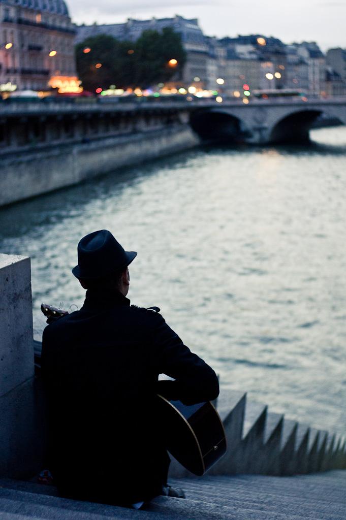 Guitarist on Quai des Orfèvres.