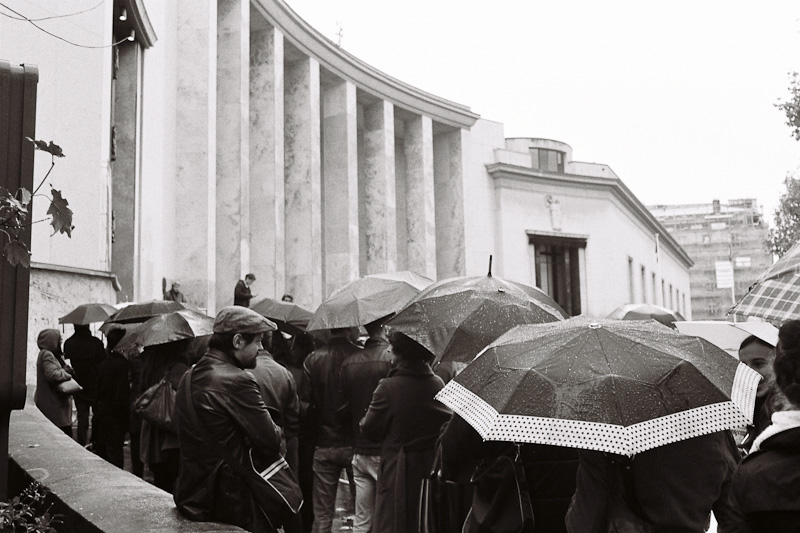 Queuing umbrellas.