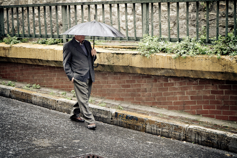 The man with the umbrella.