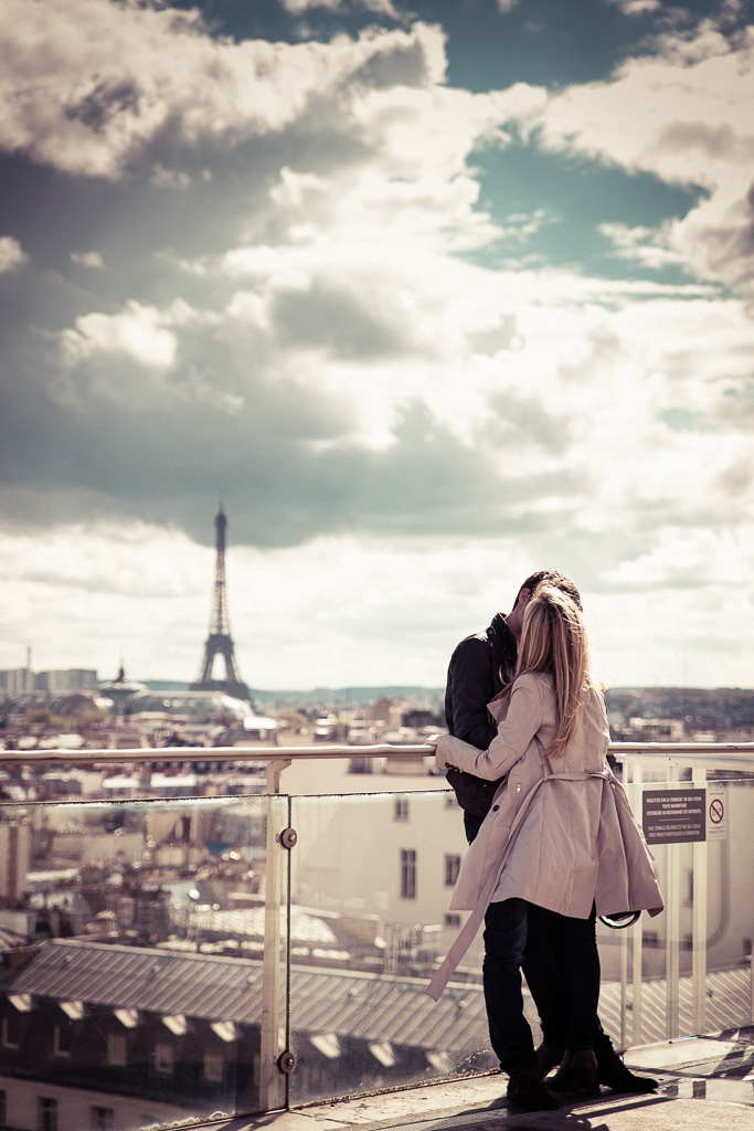 Kissing on top of Paris.