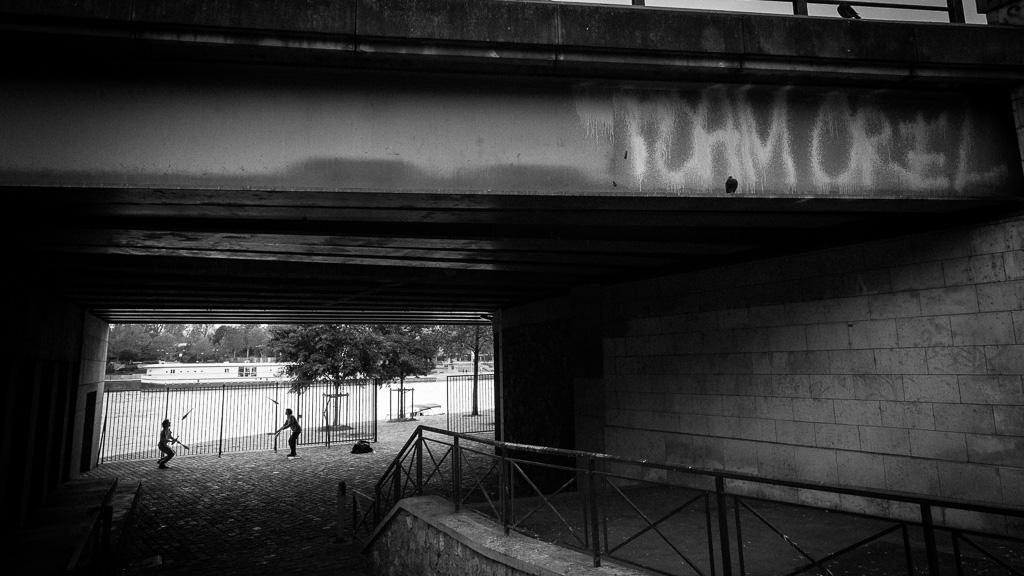 Juggling under the bridge.