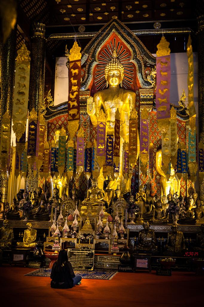 Praying to Buddha.