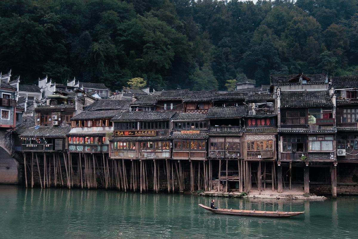 Stilt houses and long boat.