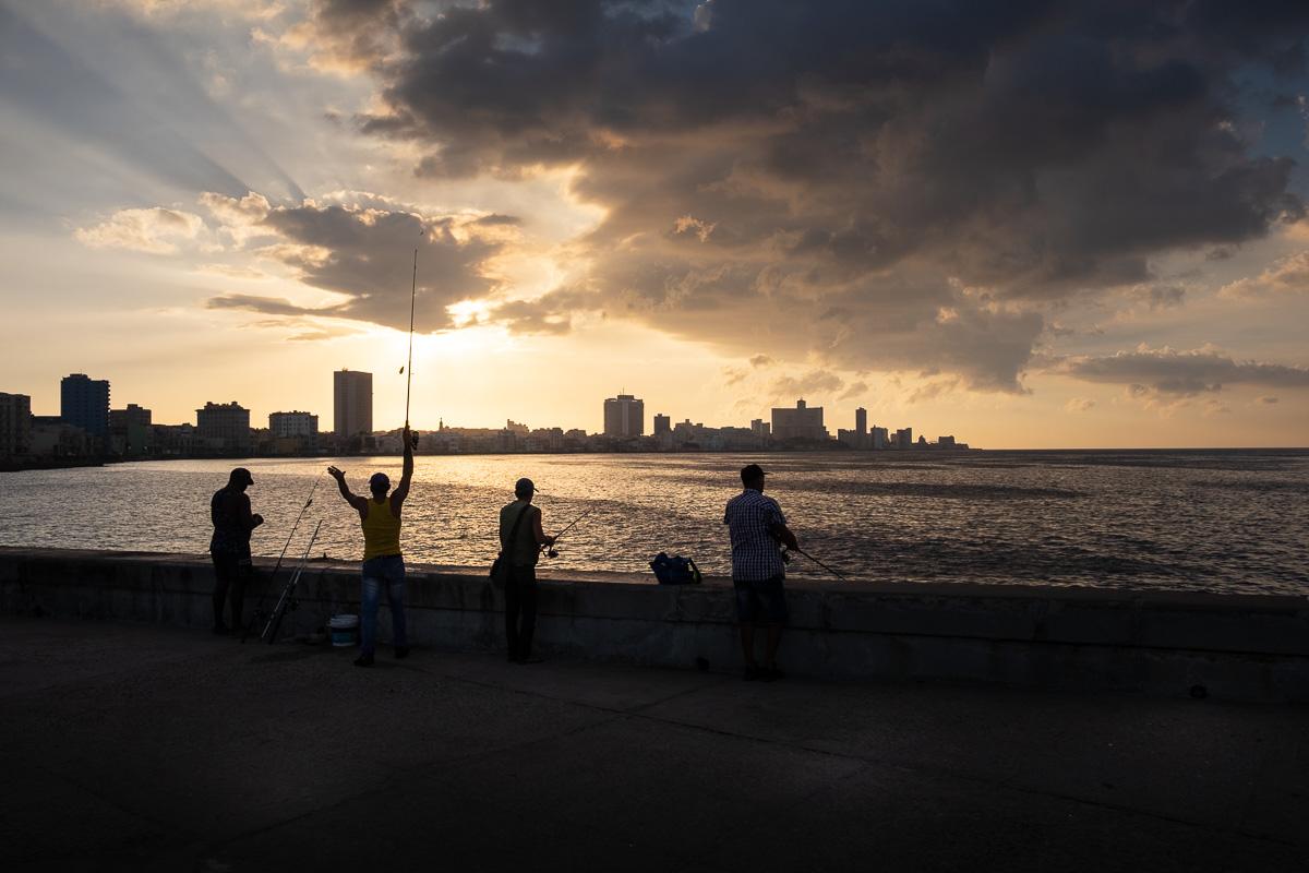 4 fishermen on the Malecón.